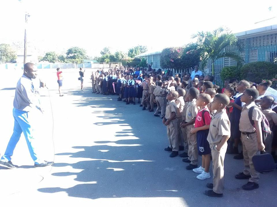 A teacher addressing students of the school (Maverley Primary and Junior High, School)