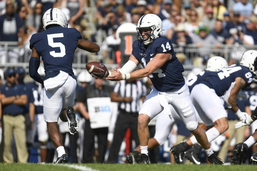 Penn State quarterback Sean Clifford (14) hands off to wide receiver Jahan Dotson (5) against Ball State during an NCAA college football game in State College, Pa.,on Saturday, Sept.11, 2021. (AP Photo/Barry Reeger)