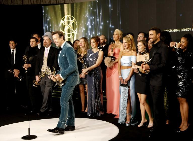 """LOS ANGELES, CA - SEPTEMBER 19: Jason Sudeikis and the cast and crew of """"Ted Lasso""""with their awards in the virtual pressroom, for Outstanding Comedy Series award during the 73rd Annual Emmy Awards taking place at LA Live on/ Sunday, Sept. 19, 2021 in Los Angeles, CA. (Al Seib / Los Angeles Times)"""