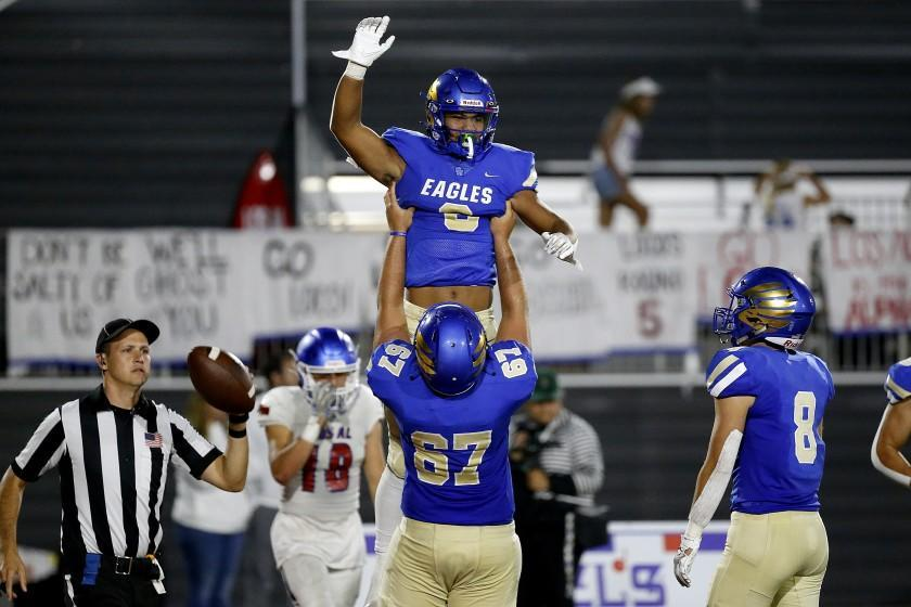 MISSION VIEJO, CA - SEPTEMBER 17: Tight end Nicholas Lopez (6), is hoisted up in the air by Kilian O'connor.