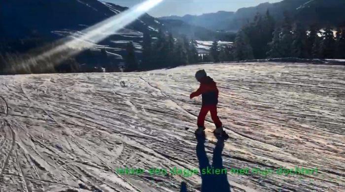 Jan Huibers skien met dochter