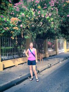 Kelly under flowering trees on a street, Cartagena, Colombia, Fantasy Aisle Travel