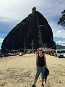 fantasy aisle, fantasy aisle travel, Fantasy Aisle travel blogger Kelly about to ascend El Peñol, the rock of Guatapé featured image