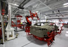 tesla robot building car