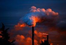 Smoke raising from factory stack