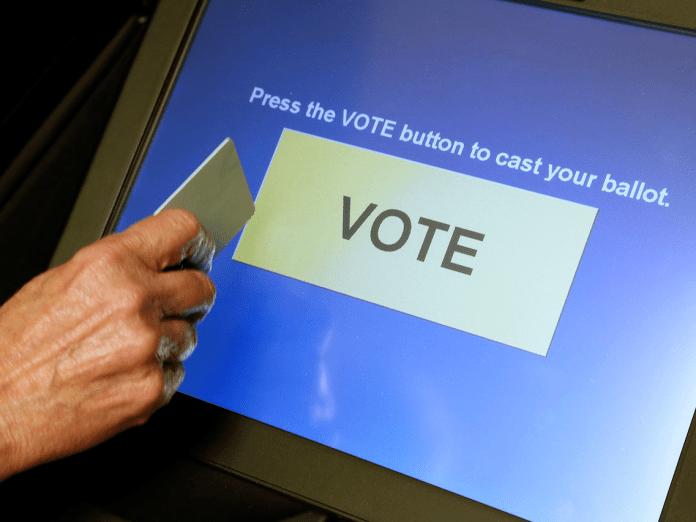 DRE voting machine at the final vote button