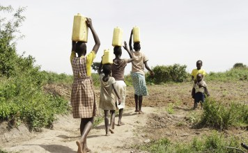 people carrying water in baskets