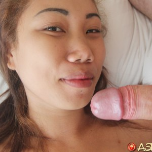 Cute Asian girl stroking fat white cock