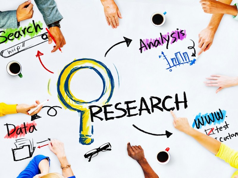 Group of People with Research Concept