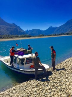 Unloading guests and gear along the banks of the bay. The final leg of the journey to arrive at Austral Kings includes a speedboat ride through the fjords and mountains of the Chilean coastline.