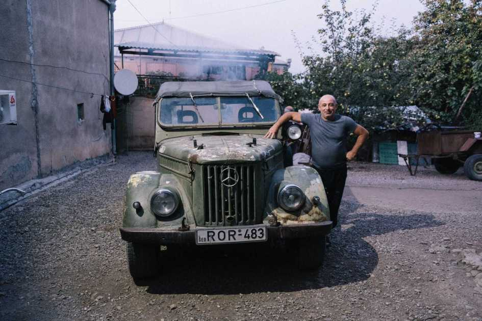 Man proudly showing his old Mercedes in Georgia