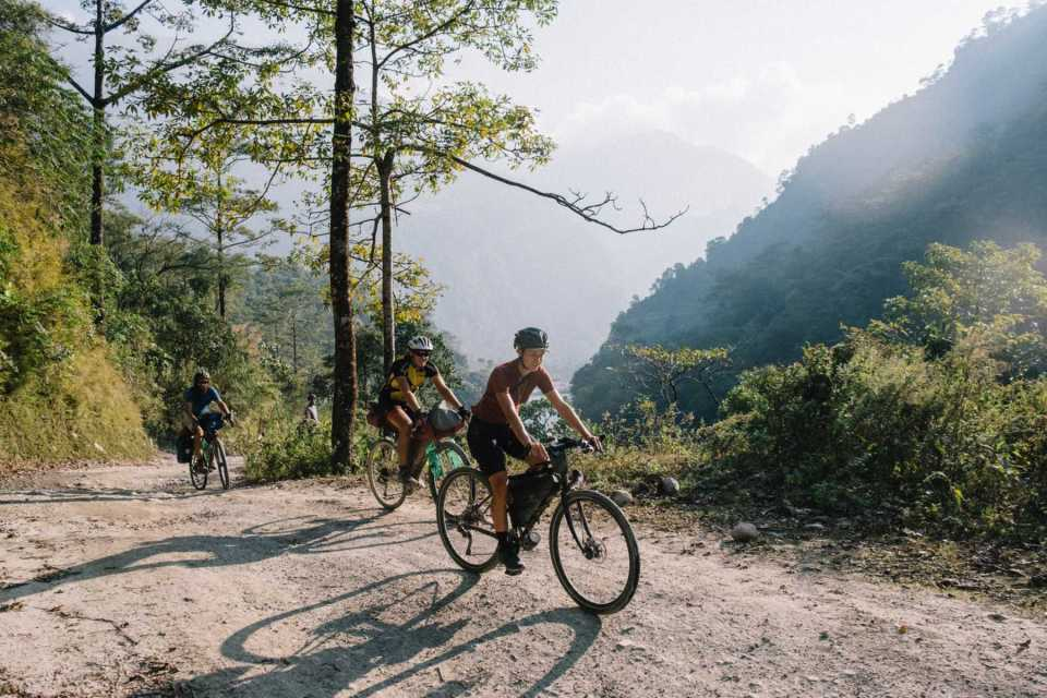Sabina cycling uphill in the Nepali Himalayan mountains