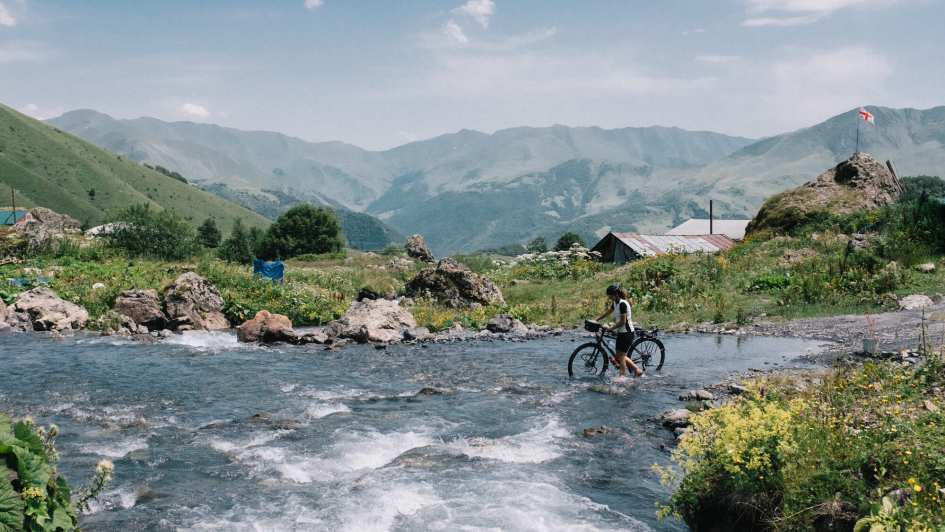 Crossing the river with a bicycle in Roshka, Georgia