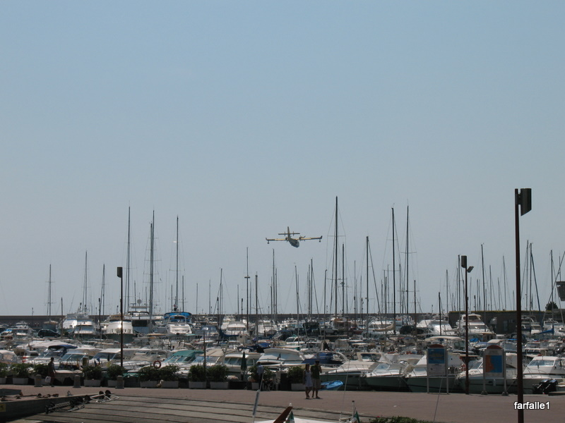Canadair flying low over port-3