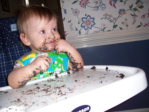 Brian covered in cake at his first birthday party