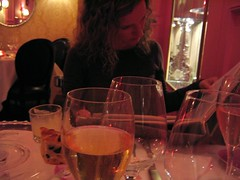 Studying the wine list at Flora, Paris