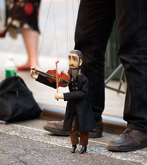 Violinist marionette performs