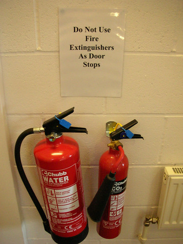 Do not use fire extinguishers as door stops by Hembo Pagi on flickr