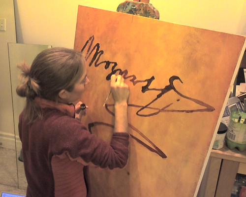 Kristin working on her latest and biggest Mozart painting