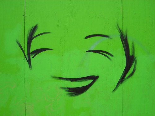 Happy Manga face on green wood by eddiemalone