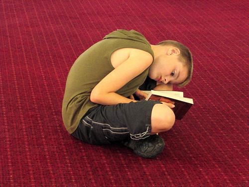 Boy Reading on a Red Carpet, Pride of Bi by Dr John2005, on Flickr