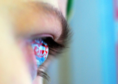 a computer screen is reflected in a child's eye