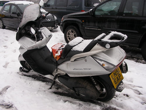 My scooter parked in the snow