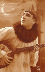 vintage photo of a man in a pierrot costume playing the banjo