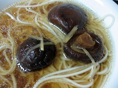 mushrooms and noodles in broth