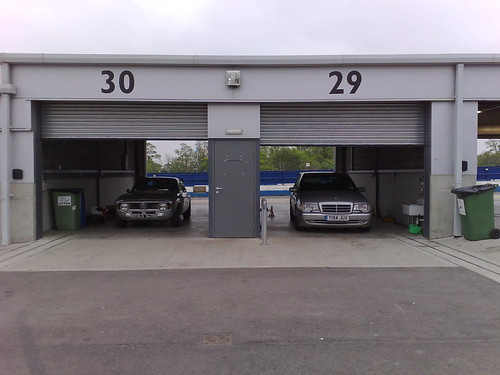 Alfa and Merc in Donnington pit garages