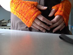 secret rib orange fingerless mitts - in action