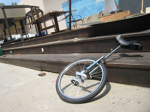 Unicycle near construction materials