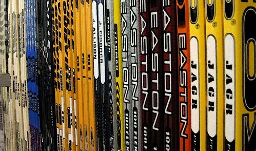 row of hockey sticks by William J. Gibson, the Canuckshutterer