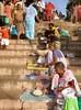 Giving alms to beggars, Dasaswameda Ghat, Varanasi