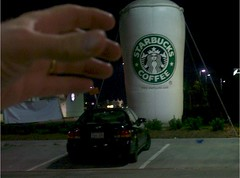 Giant Starbucks Cup and Hand 1