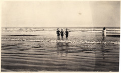 three young friends on the beach