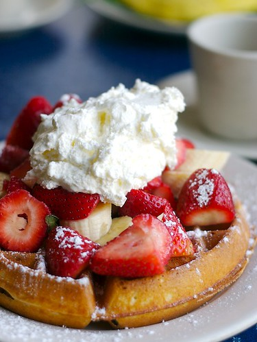 Belgian Waffles with Whipped Cream and Seasonal Fruits
