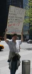 Crazy sign-holding asshat