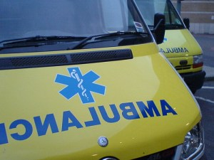 Picture of the front of an Ambulance emblazaned with the blue 'Star of Life' which incorporates the Rod of Asclepius