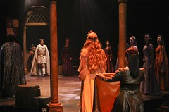 Davis Gaines (center rear), Lisa O'Hare (center, facing backward) and the knights and ladies of the court in Camelot at Music Circus August 2-7. Photo by Charr Crail.