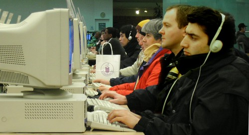 Users taking advantage of free internet at a Toronto Library. Image by Flickr user striatic.