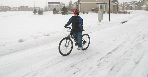 Ian rides his bike to school