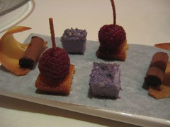 Violet marshmallow, raspberry on butter cake, and dark chocolate mousse.