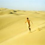 "Me Running on Sand Dunes <a style=""margin-left:10px; font-size:0.8em;"" href=""http://www.flickr.com/photos/36521966868@N01/5632049/"" target=""_blank"">@flickr</a>"