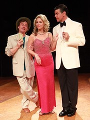"Timothy Gulan (left) as Freddy Benson, Jessica Rush as Christine Colgate and Burke Moses as Lawrence Jameson in the Music Circus premiere of ""Dirty Rotten Scoundrels"" at the Wells Fargo Pavilion August 3-8, 2010.  Photo by Charr Crail."