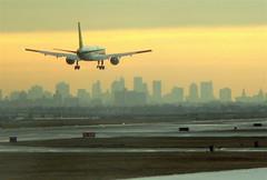 Plane landing against the Manhattan skyline