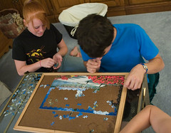 """IMG_9896: Tricia and Daniel Work on the Puzzle • <a style=""""font-size:0.8em;"""" href=""""http://www.flickr.com/photos/54494252@N00/179797159/"""" target=""""_blank"""">View on Flickr</a>"""