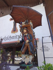 Oberammergau - a woodcarvers shop - the wooden statue is of a traveling woodcarver carrying his wares on his back to sell