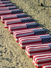 Coffins draped in flags, Santa Monica Beach