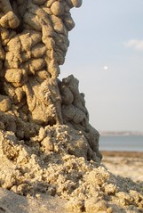 moon rises over the crumbling sand castle